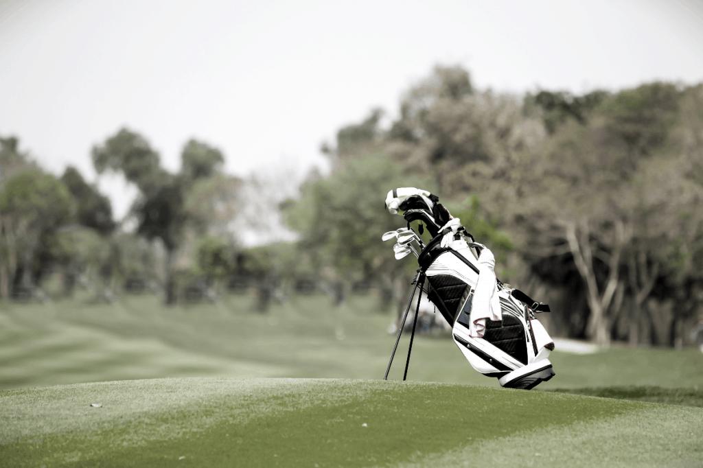 golf bag in middle of fairway