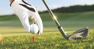 Golf Glove Placing Ball on Tee