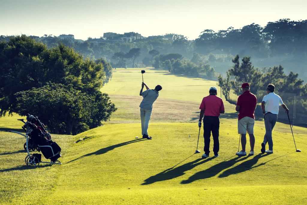 golfers standing on tee box