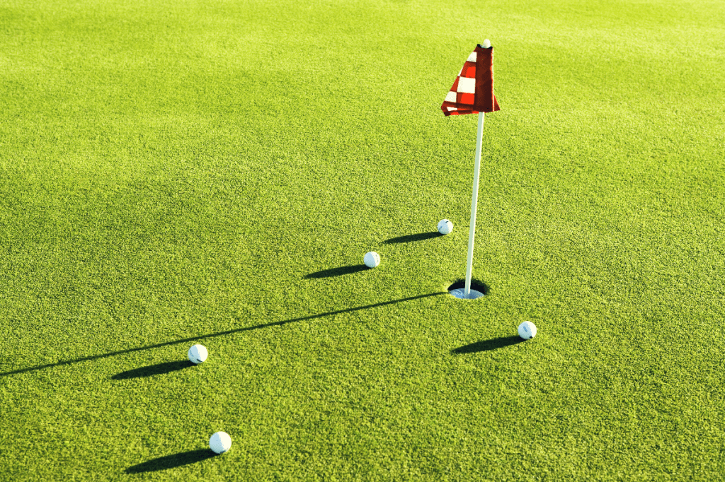 putting green with golf balls