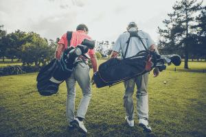 golfers walking up the fairway