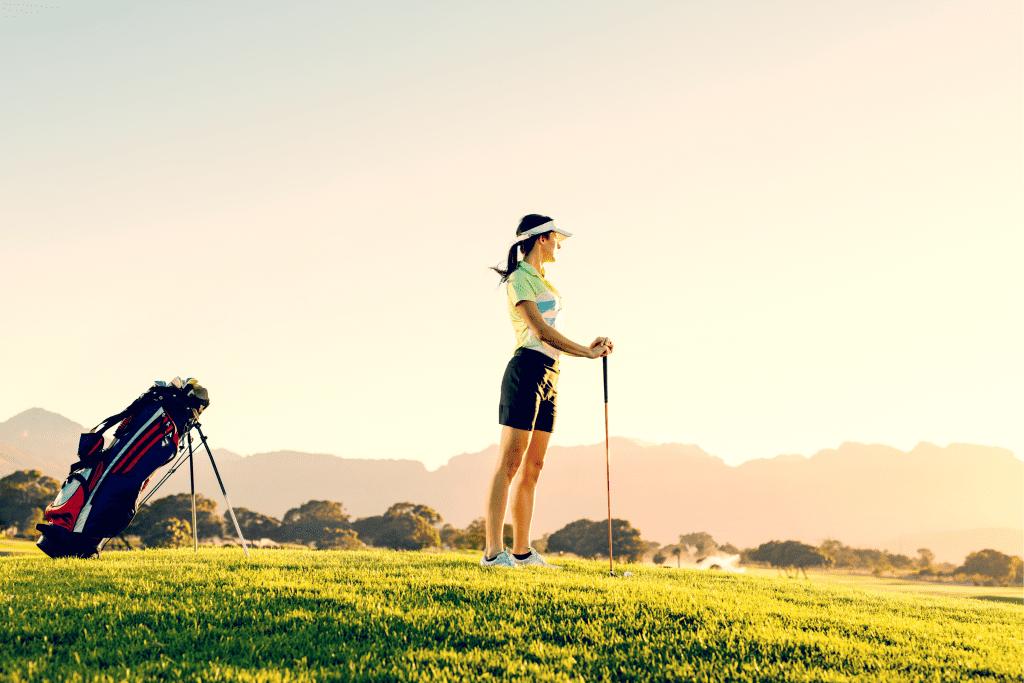 Woman on Tee with Golf Bag