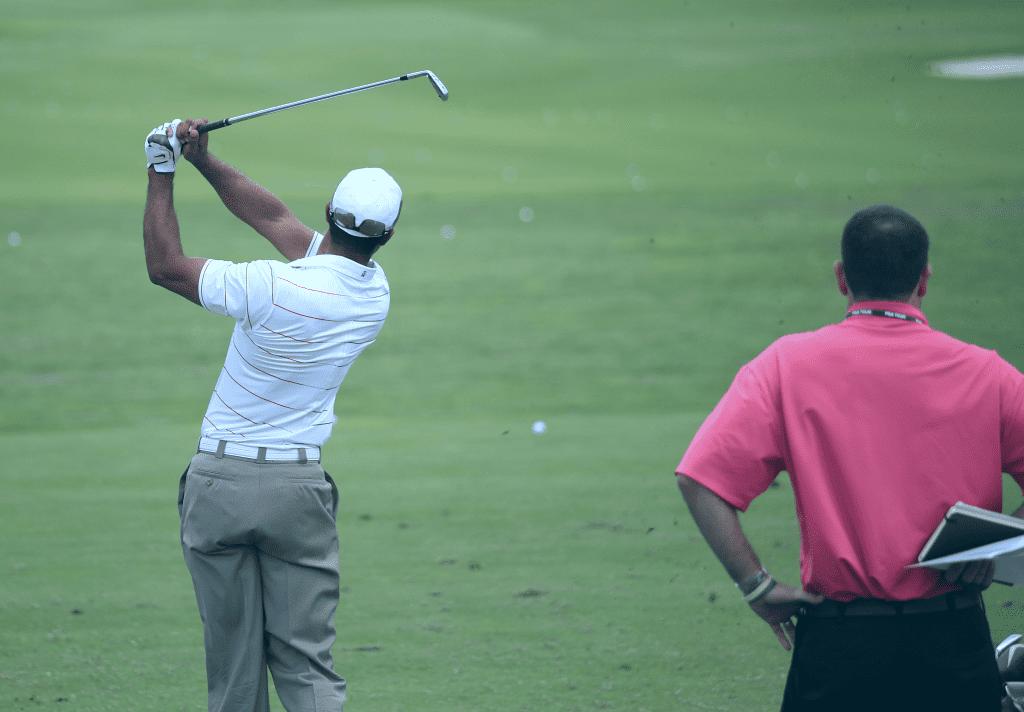 Golfer hitting shot during practice